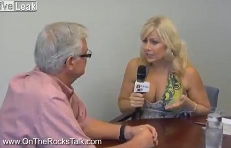 Topless reporter #14